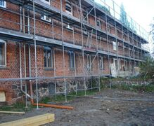 Scaffolding during replacement of roof tiles and renovation of roof beams
