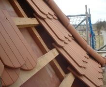 roof during fitting of new roof tiles