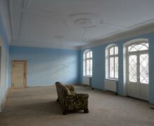 The large hall in the manor house is reconstructed with stucco in Art Nouveau style